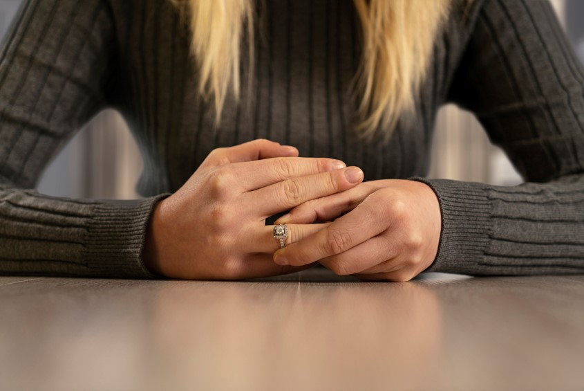 Women removing ring after divorce